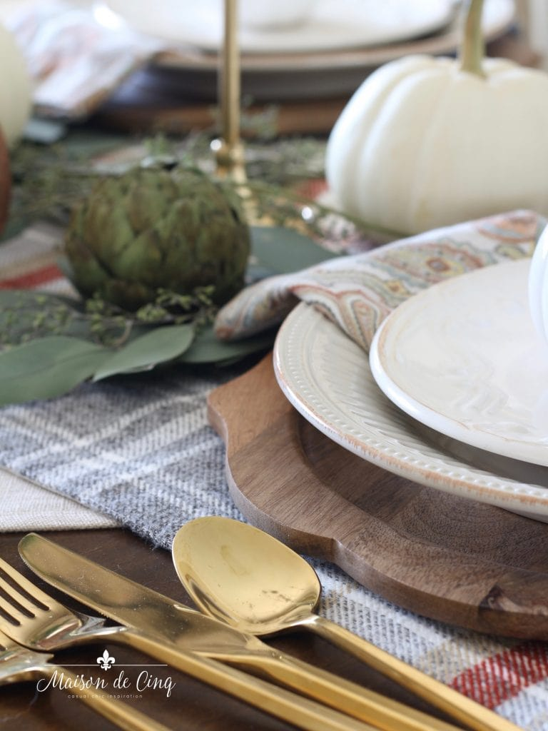 wood chargers artichokes and white pumpkins fall or autumn table setting