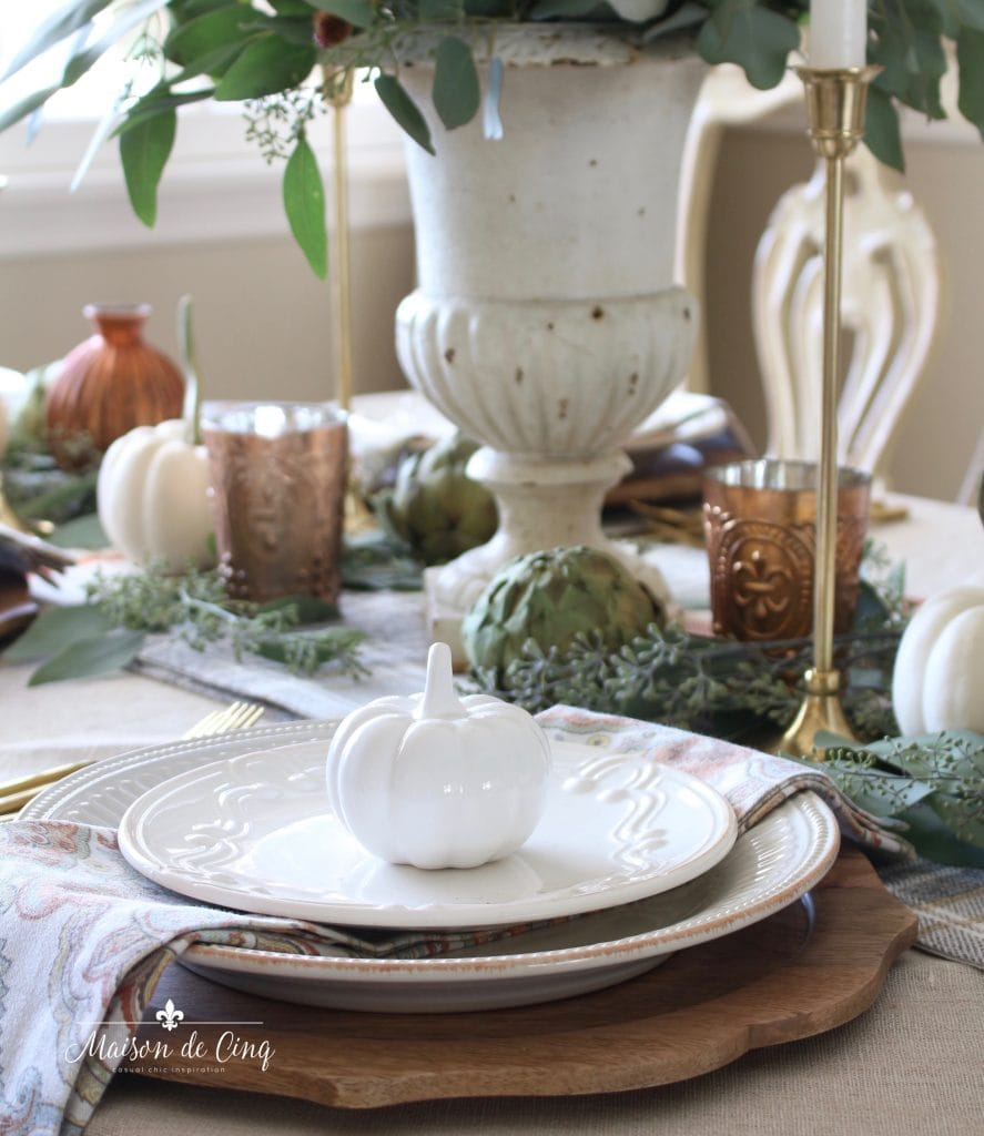 fall thanksgiving table setting with white pumpkins wood chargers and copper