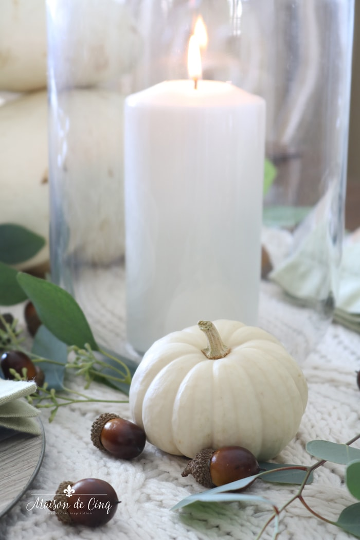 candle and white pumpkins fall tablescape autumn table setting idea