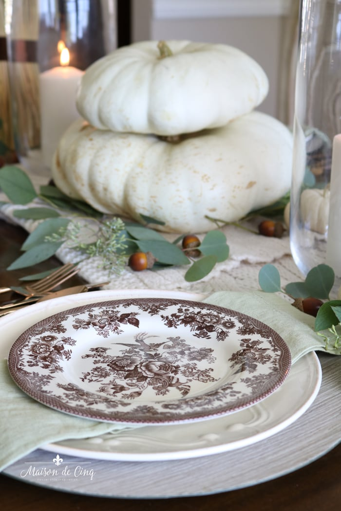 white pumpkins acorns and eucalyptus create warm fall table setting ideas