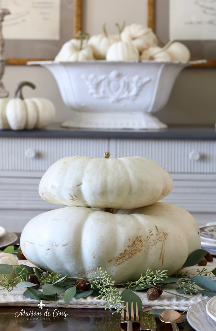 white pumpkins green seeded eucalyptus thanksgiving table fall tablescape ideas