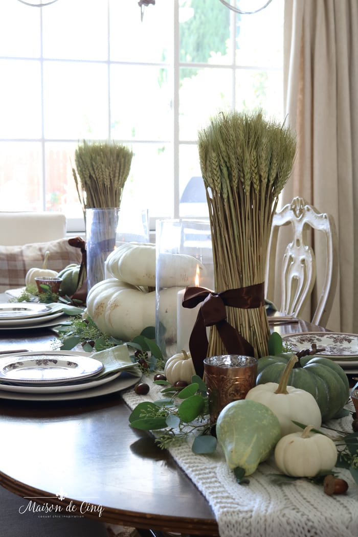 gorgeous fall tablescape white and green pumpkins and wheat shafts