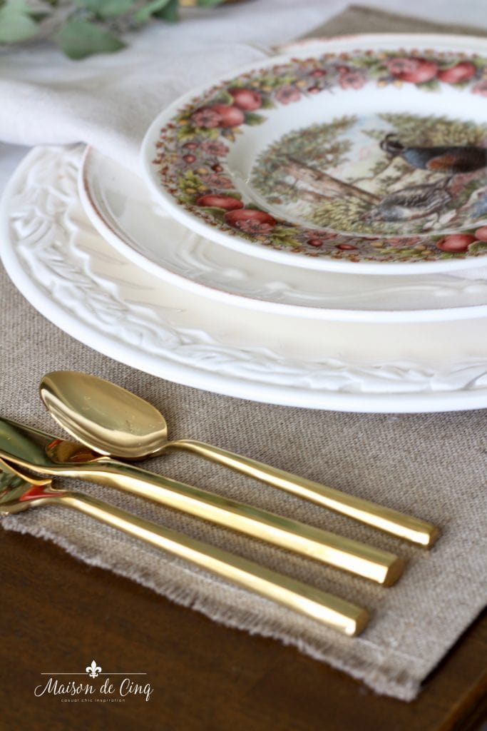 gold flatware white chargers and transferware plates autumn table setting