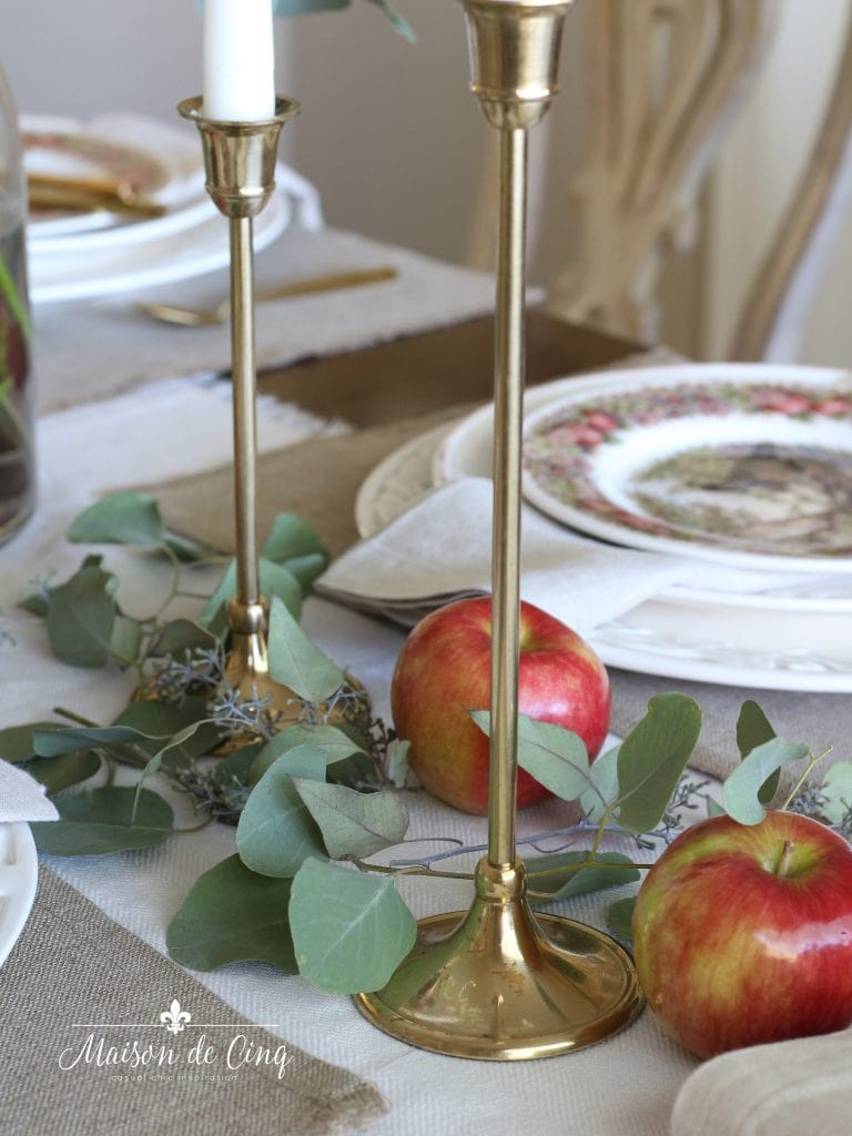 brass candlesticks candleholders apples and eucalyptus fall tablescape