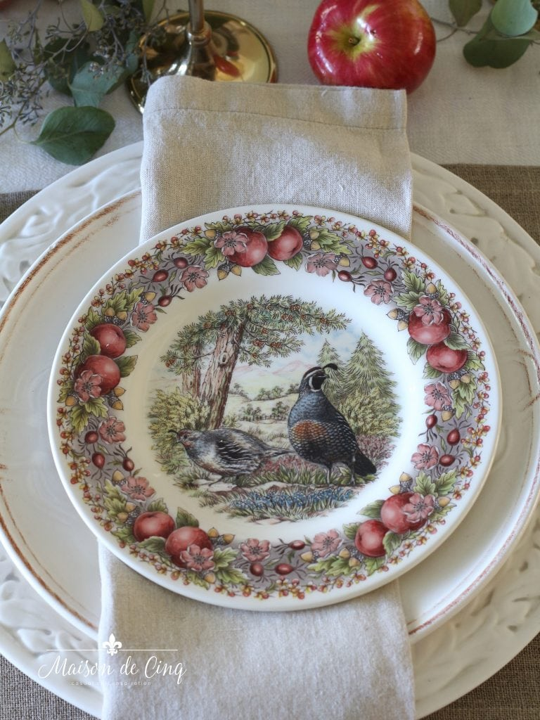 charming fall transferware plates with apples linen napkin and white charger plates