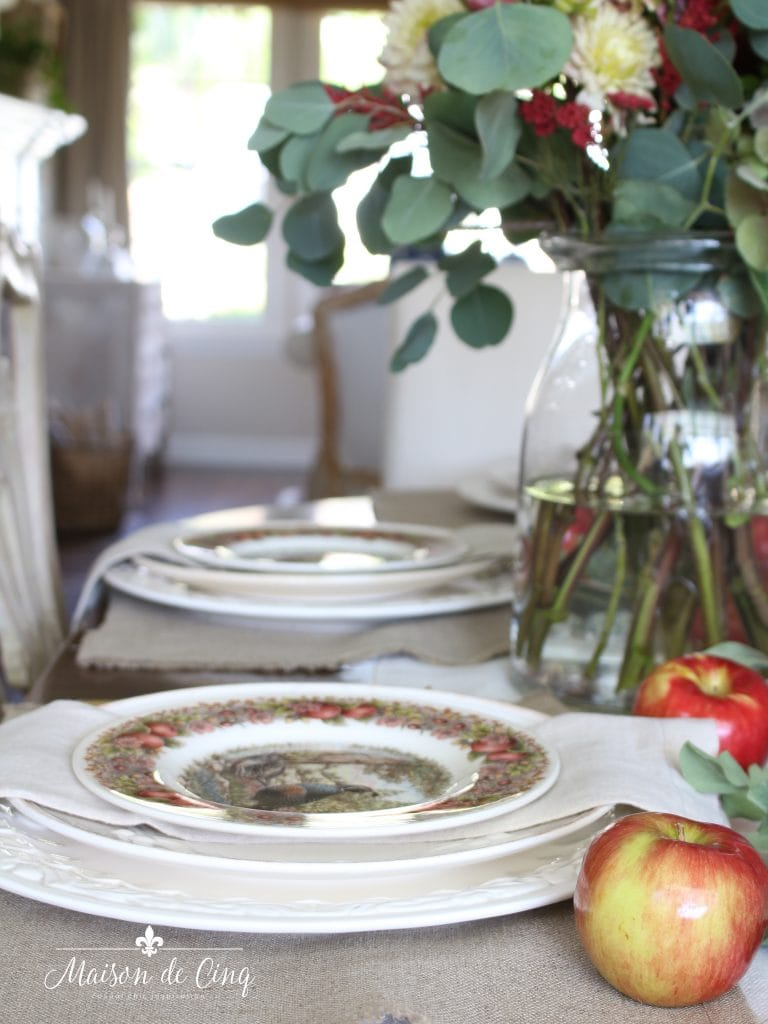 fall autumn table with apples gorgeous florals and white charger plates
