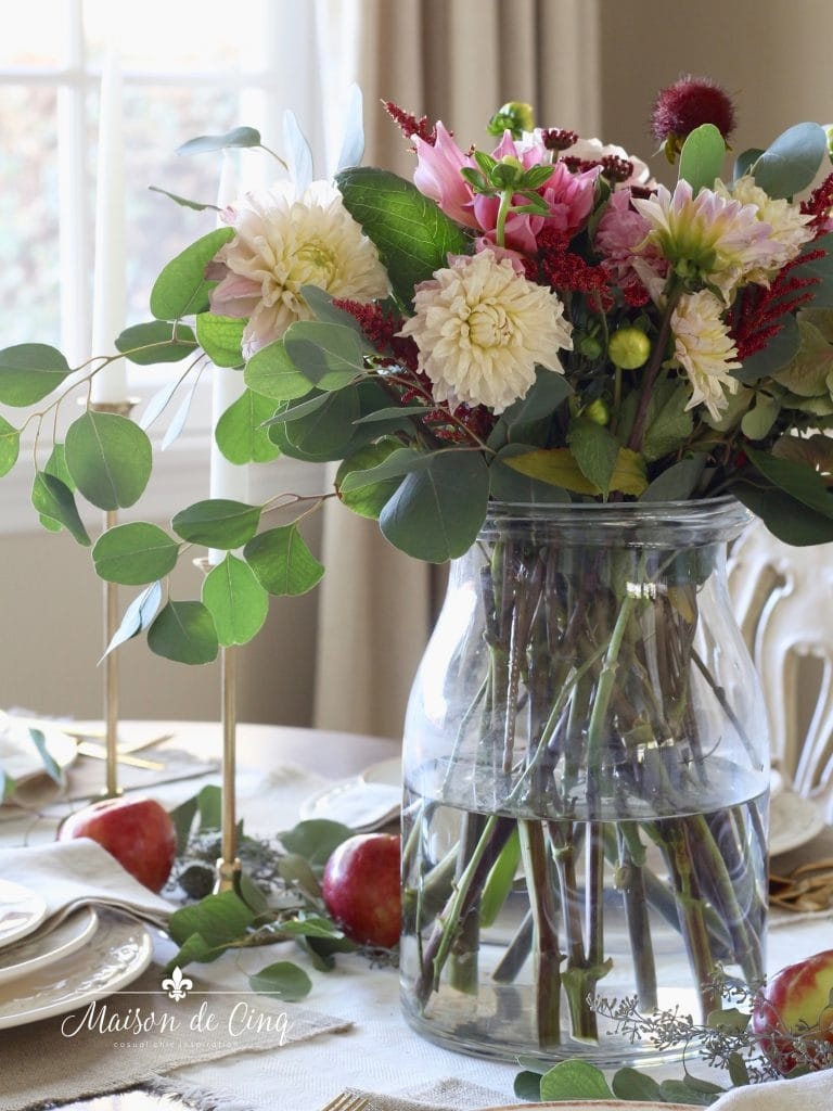 stunning early fall florals centerpiece with creme and pink dahlias