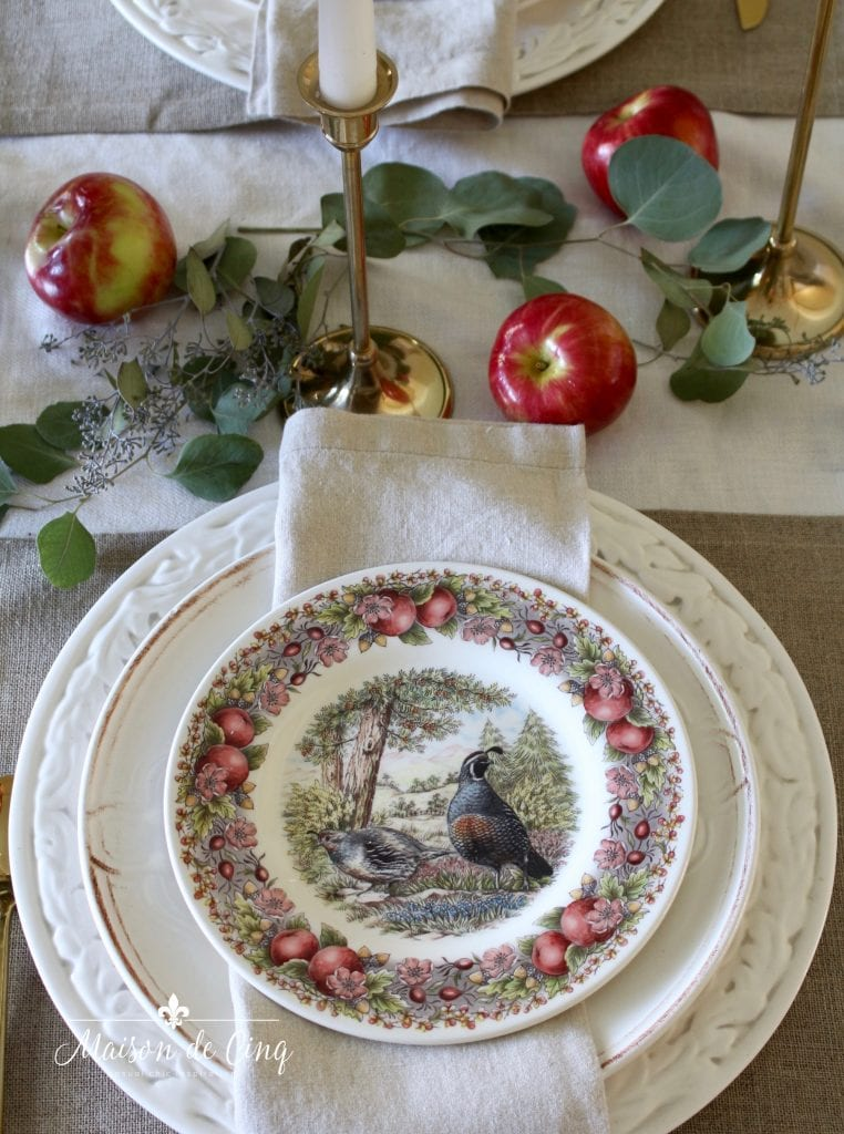 gorgeous fall tablescape with charming quail plates apples and eucalyptus