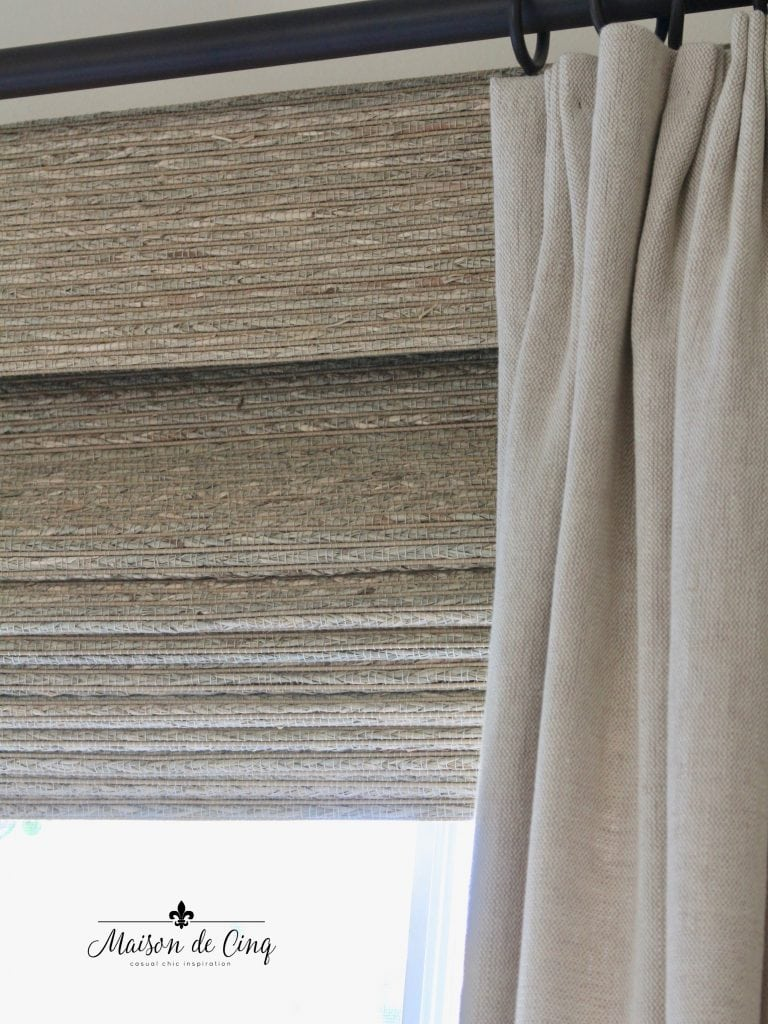 woven wood shades close up with linen drapes