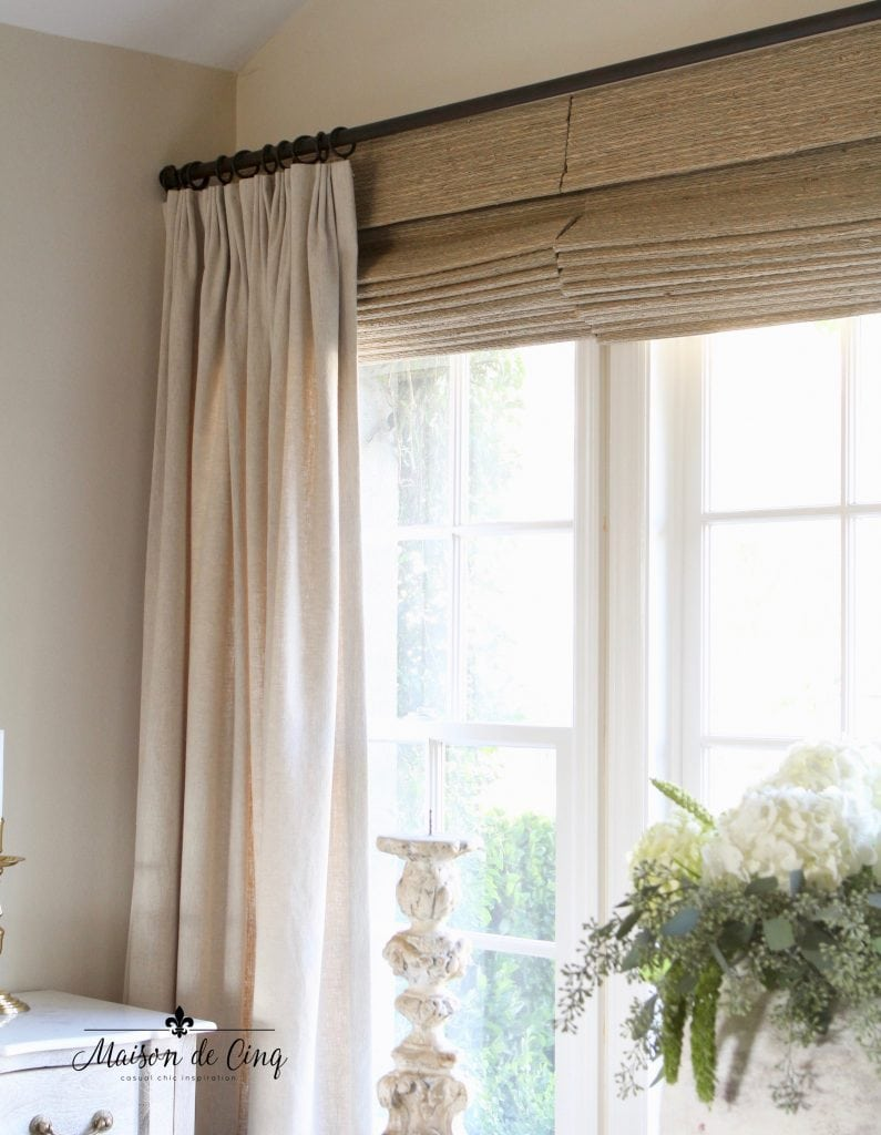 window treatments linen drapes and woven wood shades