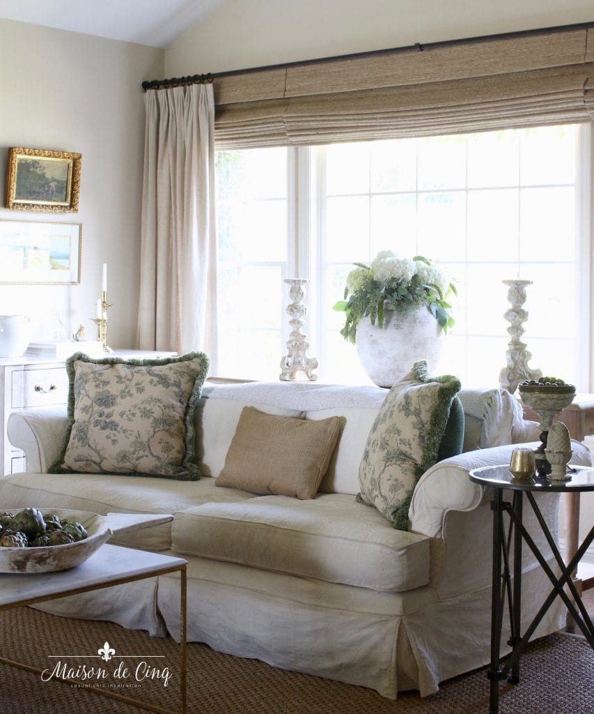 gorgeous French country living room neutral decor sofa floral pillows shades