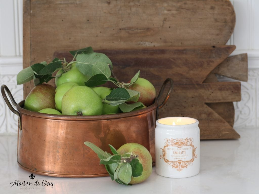 neutral and natural fall decor using apples in copper pot