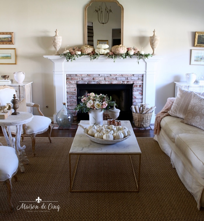 gorgeous French farmhouse living room mantel decorated for fall pink and white pumpkins and roses