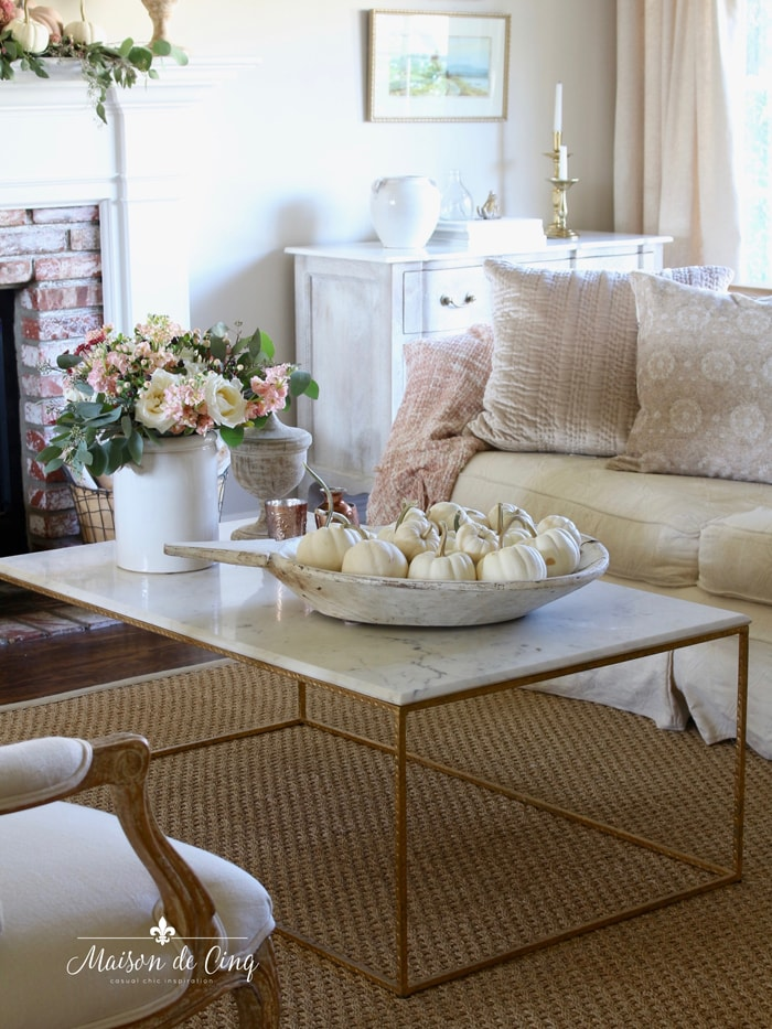 soft colors of fall pink roses white pumpkins in gorgeous French country living room