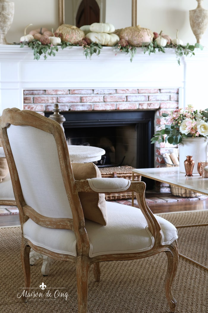 pink and white pumpkins fall mantel French country chair gorgeous living room