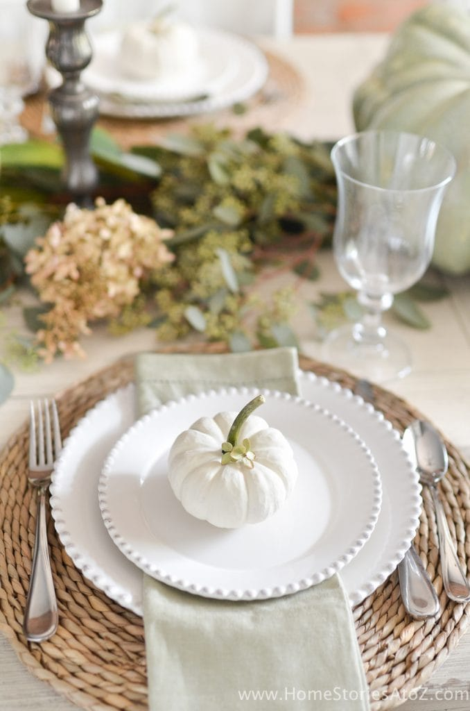 neutral fall tablescape with hydrangeas and white pumpkins