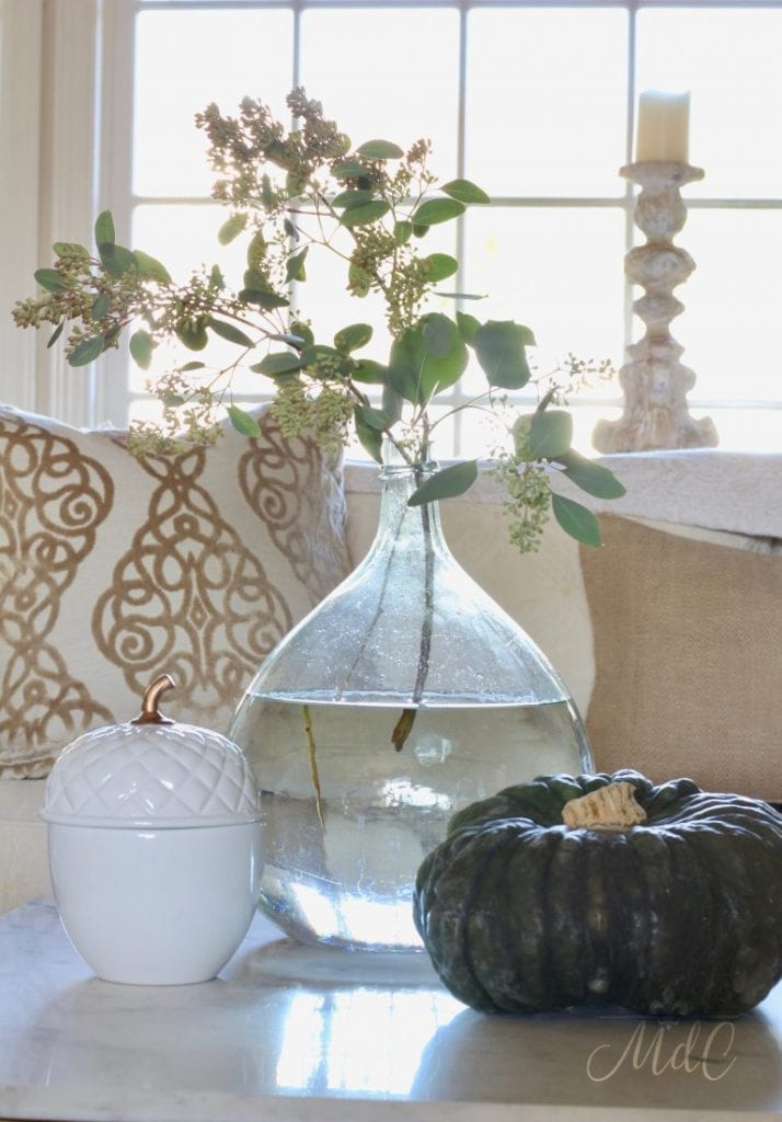 eucalyptus in French demijohn with pumpkins fall decorating idea
