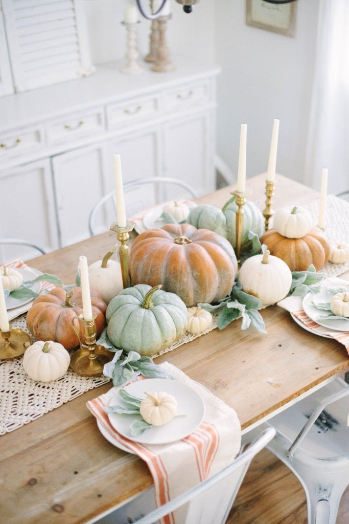 green and orange pumpkins centerpiece Thanksgiving table setting
