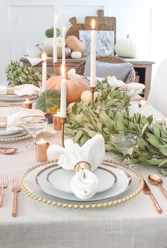 stunning Thanksgiving table with pumpkins and eucalyptus garland