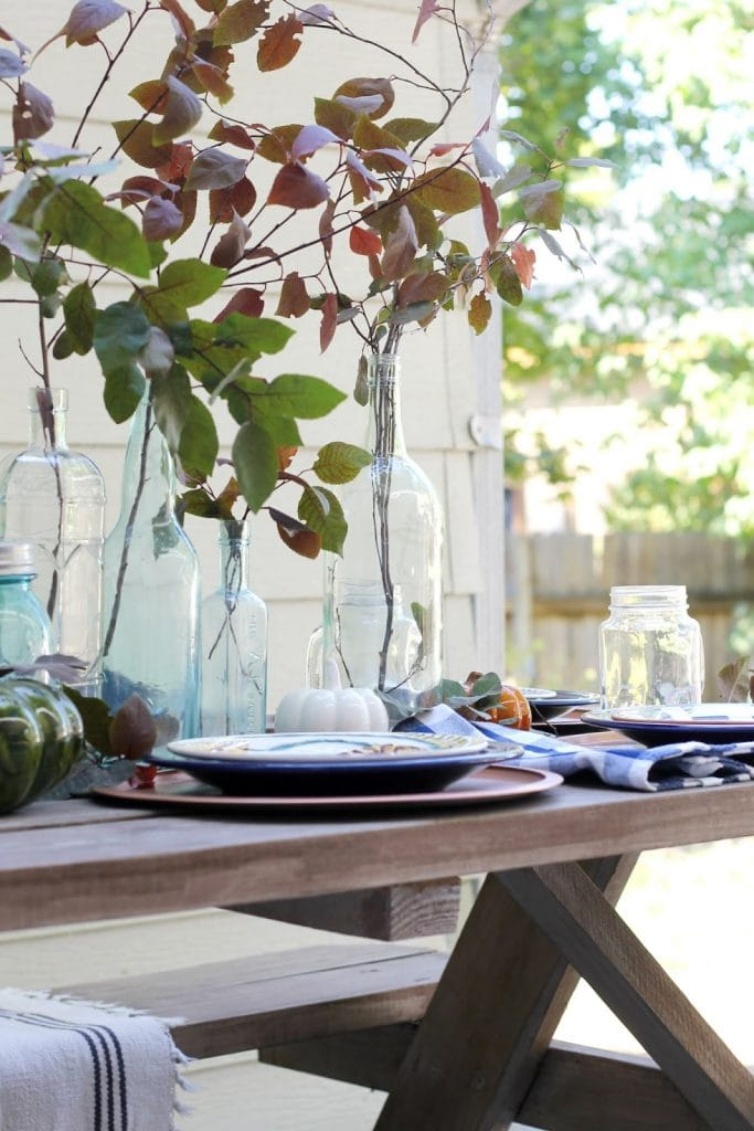 pretty leaves in bottles fall table setting