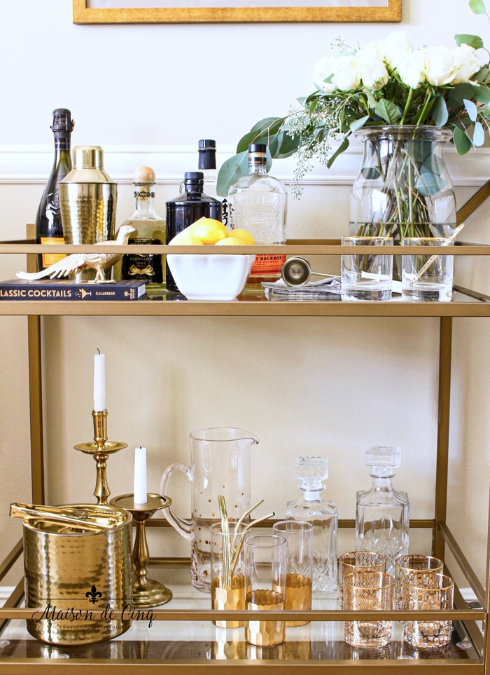 gorgeous bar cart styling with white roses brass accessories in dining room