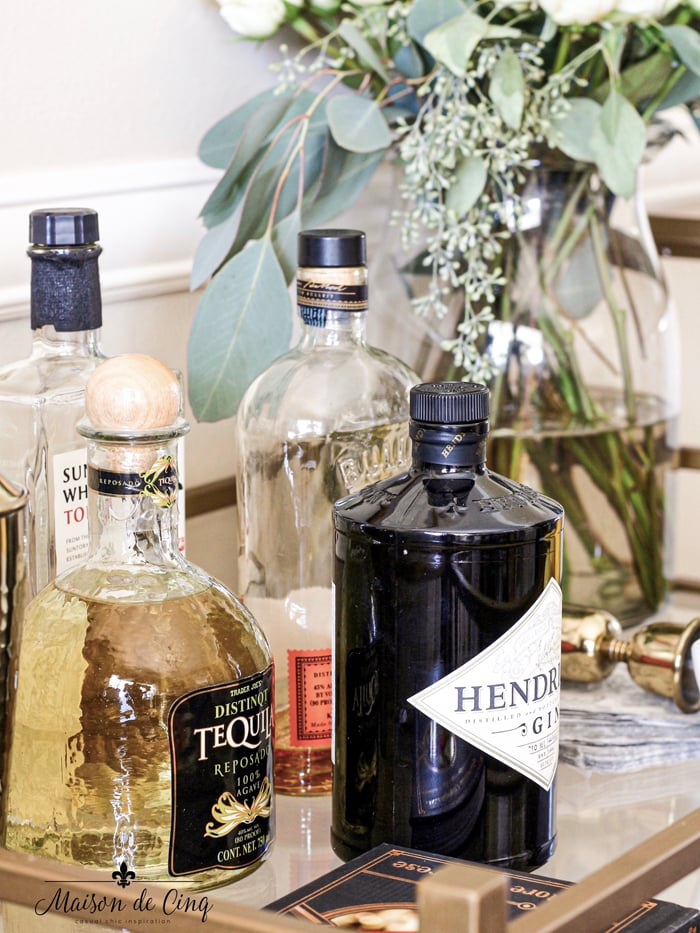 liquor bottles on bar cart