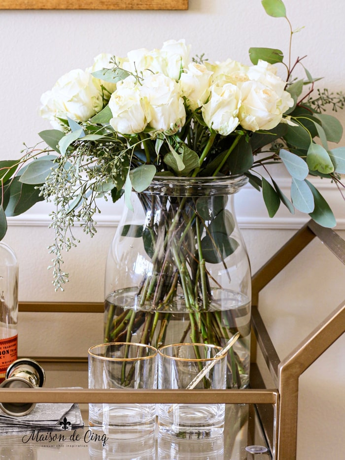 white roses on bar cart gorgeous styling