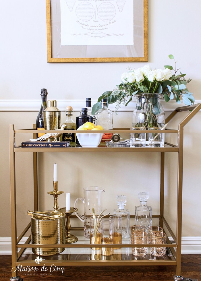 bar cart styling brass bar cart with flowers bottles and accessories