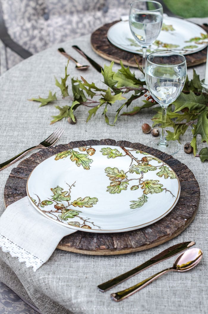 Thanksgiving table with leaf plates and acorns