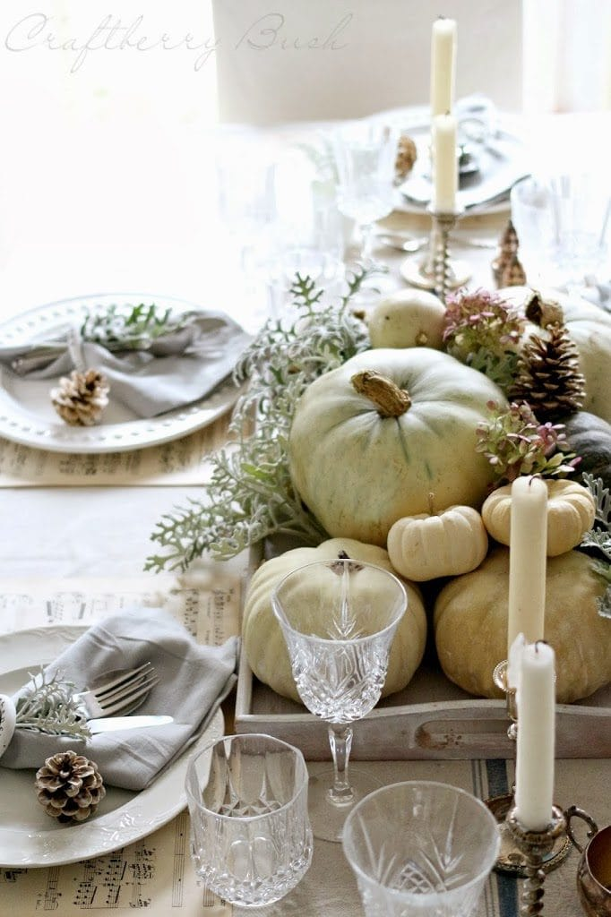 gorgeous neutral fall table setting with white pumpkins and pinecones