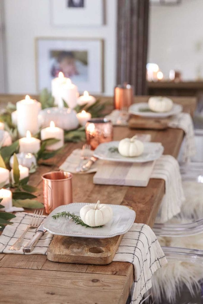 farmhouse inspired Thanksgiving table setting in black and white with copper
