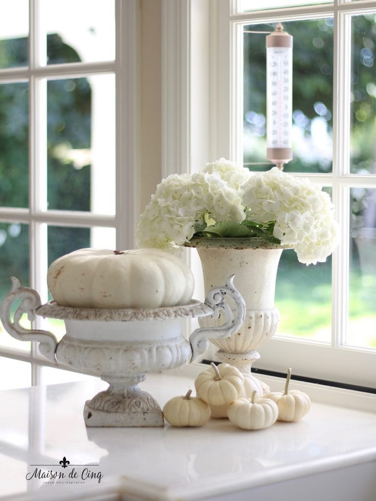 neutral fall decor with white pumpkins and French urns stunning French country fall decor