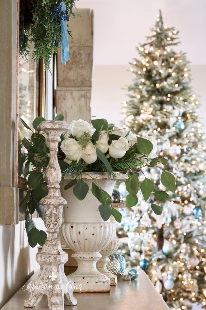 white roses in French country entry way with gorgeous Christmas tree holiday decorating ideas
