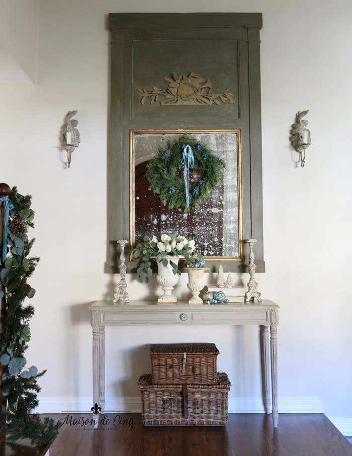 holiday entry way French country farmhouse style trumeau mirror with wreath, garland, and touches of blue