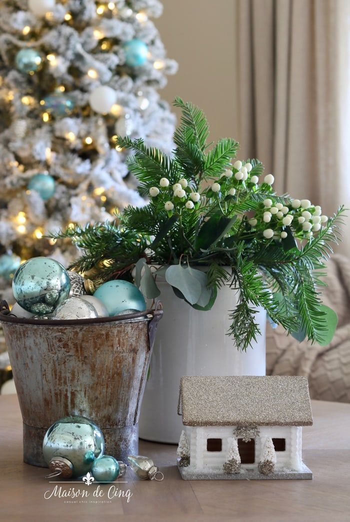 gorgeous French blue holiday decor with bucket, ornaments, and greens