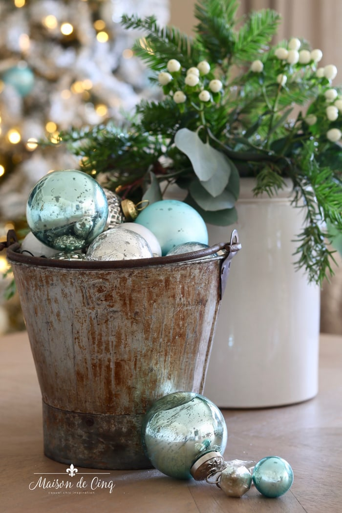 farmhouse bucket with blue Christmas ornaments holiday decorating ideas