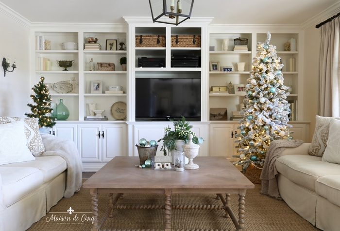 French farmhouse blue Christmas holiday decorating ideas family room with built ins flocked tree