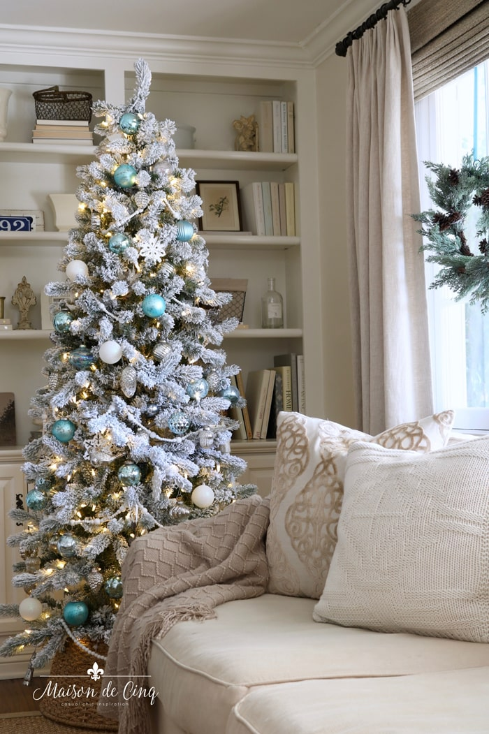gorgeous blue Christmas tree in neutral French country family room wreath