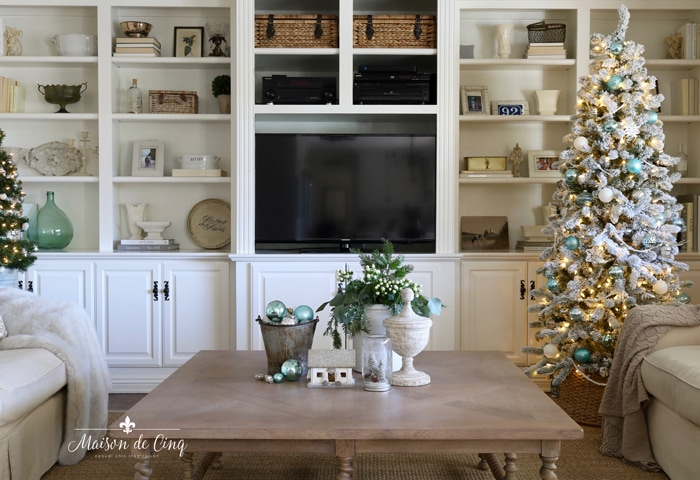 French country family room with blue Christmas tree and built ins neutral decor