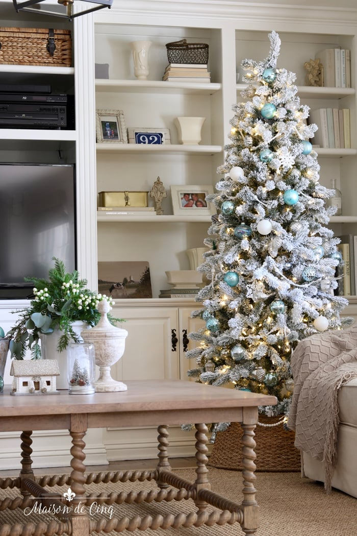 gorgeous French country family room with flocked tree blue Christmas decor