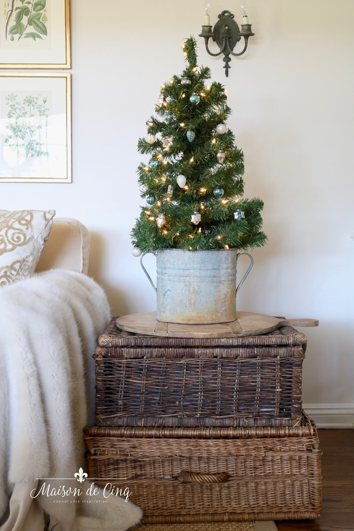 cute little Christmas tree with blue ornaments on baskets farmhouse holiday decorating