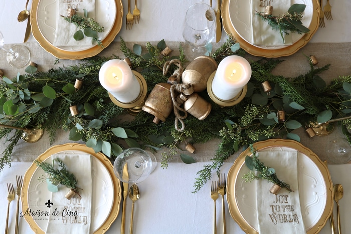 gorgeous holiday table centerpiece with pine, eucalyptus and brass candleholders