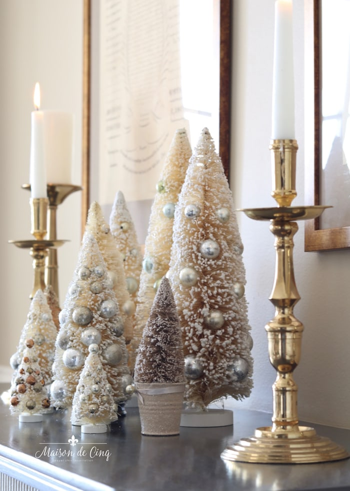 bottle brush trees and brass candleholders holiday decorating ideas