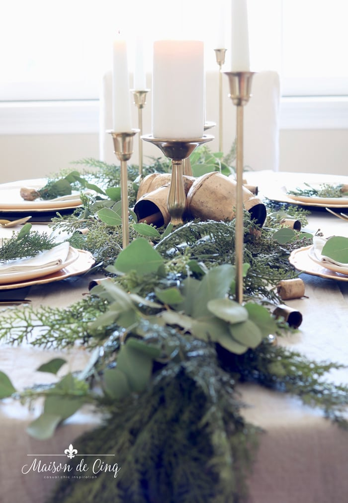 gorgeous centerpiece with pine garland and eucalyptus