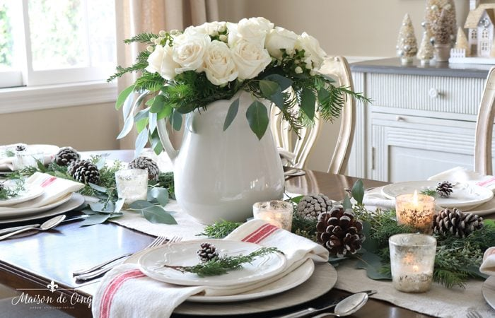 Classic Christmas Table Setting with Roses, Pinecones and Greenery