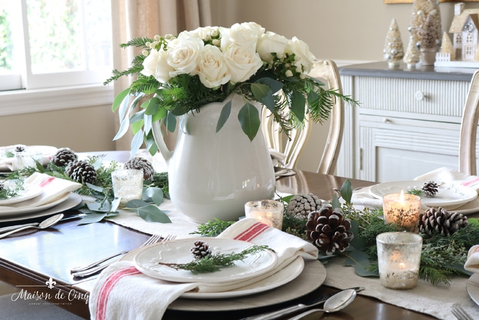 classic christmas table with white roses pinecones centerpiece