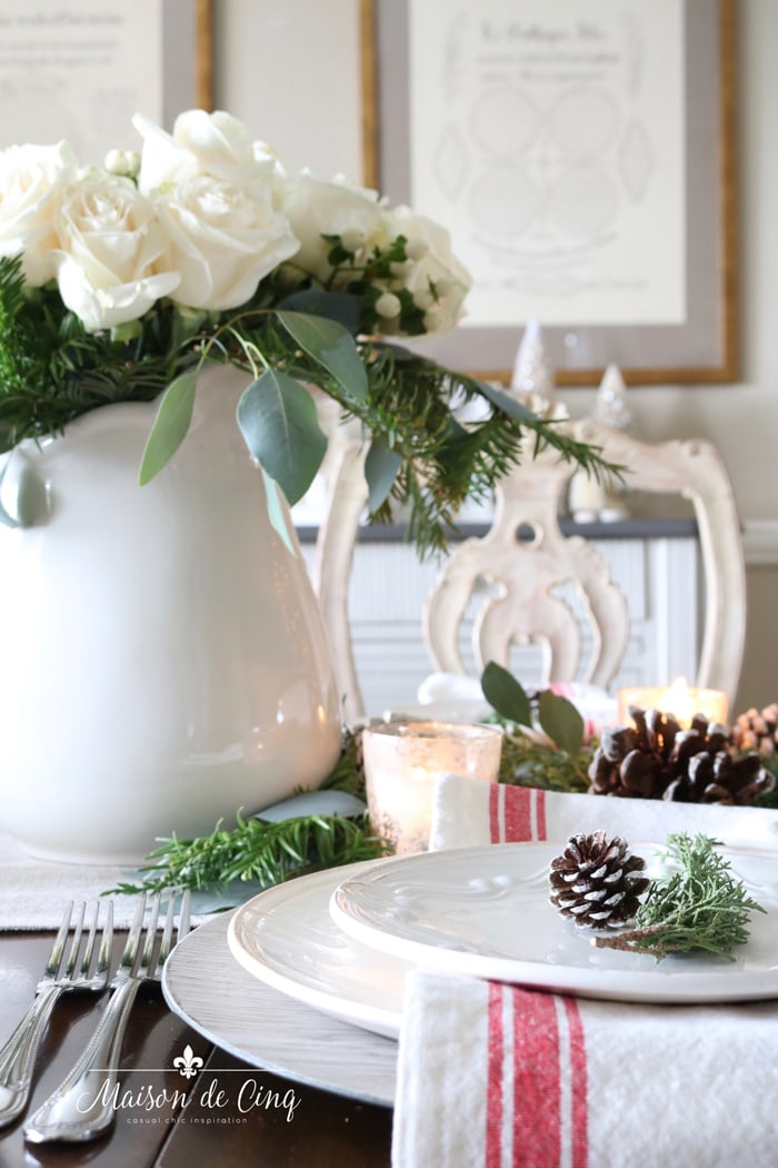 stunning christmas table with roses pinecones and greens