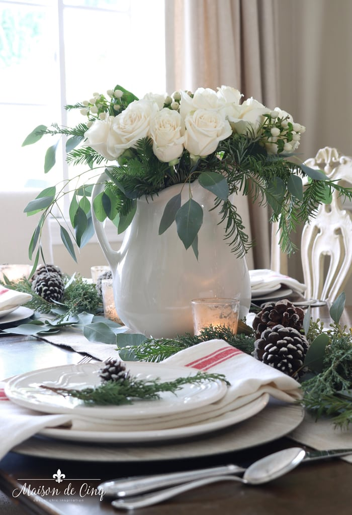 centerpiece of white roses on gorgeous red and white christmas table setting