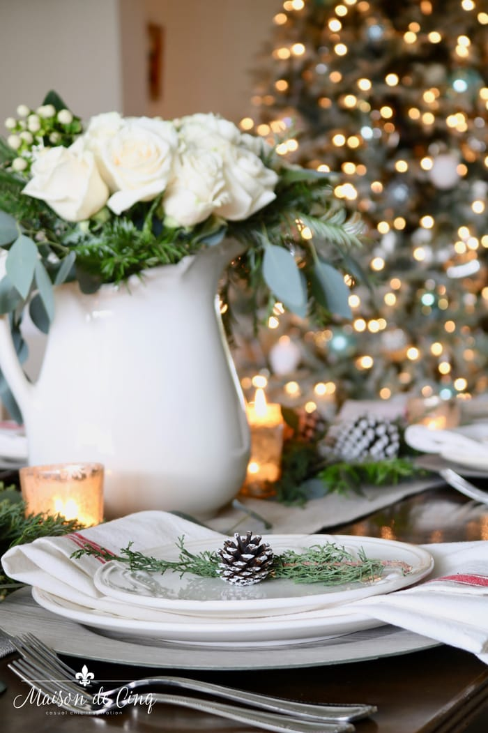 christmas table setting with gorgeous tree in background