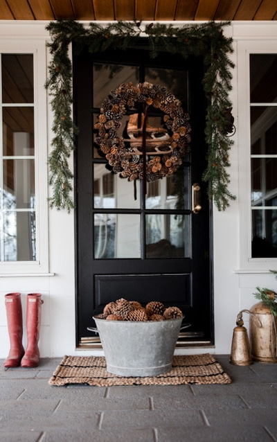 Boxwood Avenue farmhouse christmas porch with wreath and garland